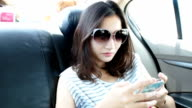 Attractive young woman with sunglasses using mobile phone video