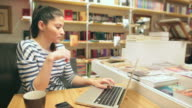 Attractive young woman working at her laptop. video