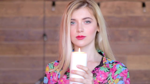 Attractive young women with candle in arms. Never again. Feel pain, lost someone video