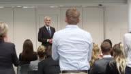 Audience Applaud Speaker After Presentation Shot On R3D video