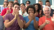 Audience Clapping At Outdoor Event In Slow Motion video