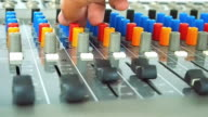 Audio Engineer adjusting on mixing console video