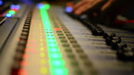Audio Engineer Working on music studio mixer video