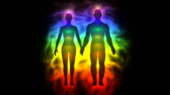 Aura and chakras - silhouette of woman and man video