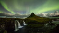 T/L Aurora Borealis over Kirkjufellsfoss waterfall video