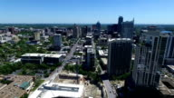 Austin Texas Aerial Sunny Day time moving away from downtown high above the city drone footage video