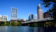 Austin Texas Skyline Clear Blue Sky Sunny Day Near Congress Bridge with Kayake passing by video