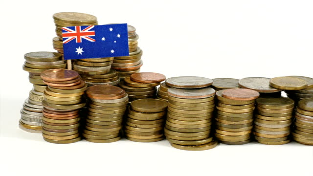 Australia flag with stack of money coins video