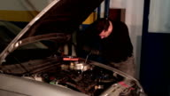 Auto mechanic repairing a part of car engine video