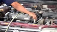 auto mechanic technician cleaning automobile engine video