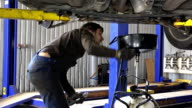 auto mechanic technician replacing and changing motor oil video