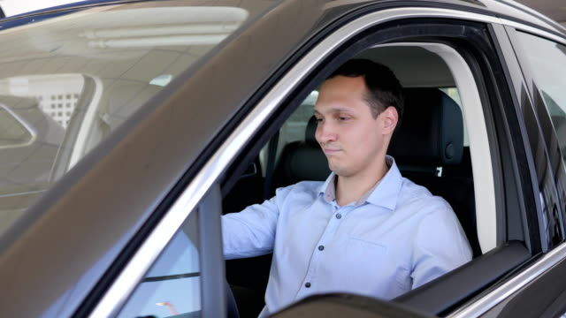 auto shop, positive gesture of consumer, car keys In hands of men video