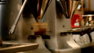 Automated coffee grinder filling container video