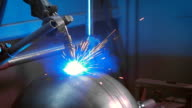 Automated electric welding on factory. Sparks fly in different directions video