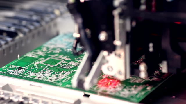 Automated electronics parts manufacturing line. Citcuit board production video