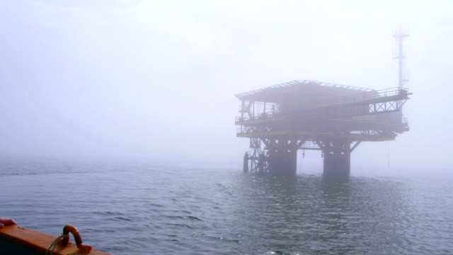 Automated gas production offshore platform in the misty sea video