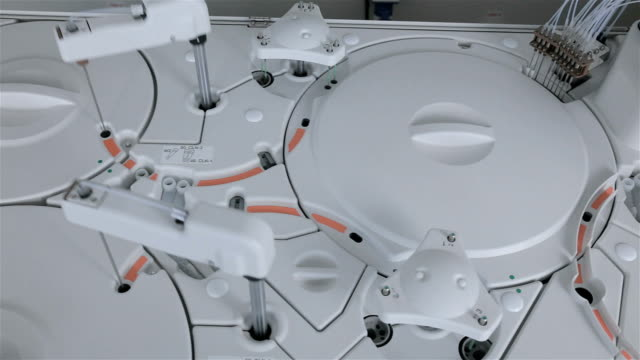 Automated pharmaceutical, medical equipment works in modern laboratory video