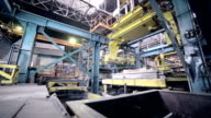 Automated robotics welding line at a heavy industry plant video