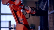 Automatic robot works in production line parts at factory assembling parts video