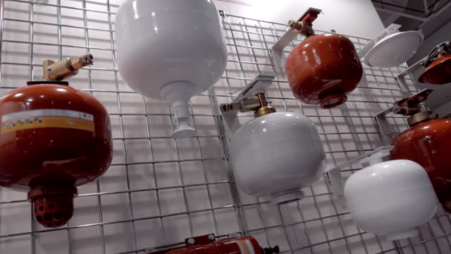 Automatic, wall extinguishers in red and white colors at the exhibition video
