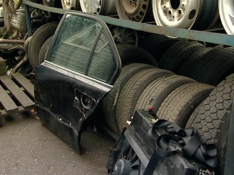 automobile parts in dump. wheels and other used objects video
