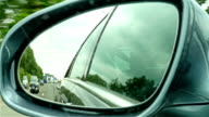 Automotive: Highway view on side mirror of a car video