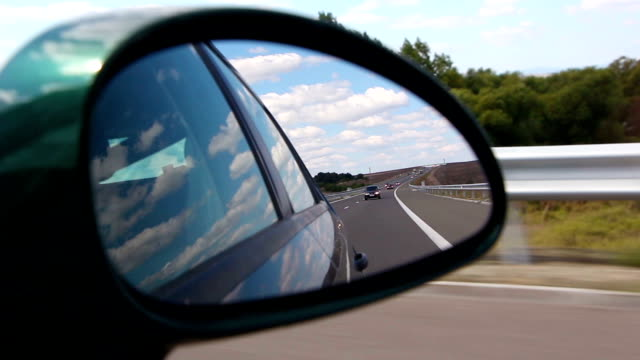Automotive-Highway view on side mirror of a car video