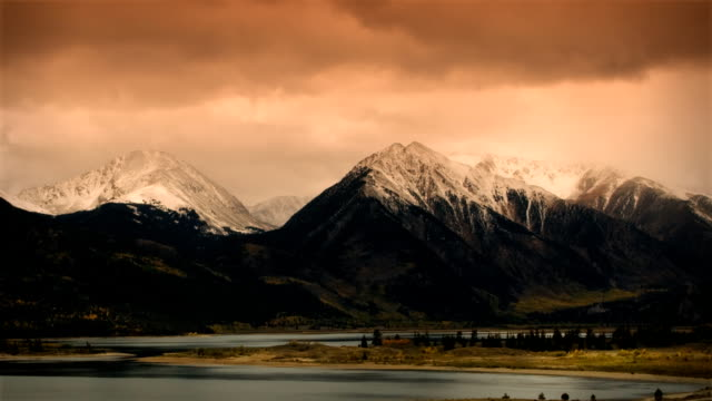 Autumn Early Snow Storm Sunrise Timelapse Mountains and Aspen Colors video