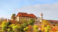 autumn forest with building placing on hill in Brno, Czech Republic video