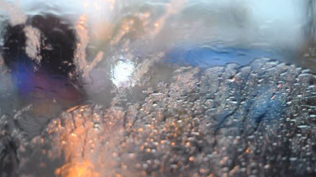 Autumn rain water drops on glass surface video