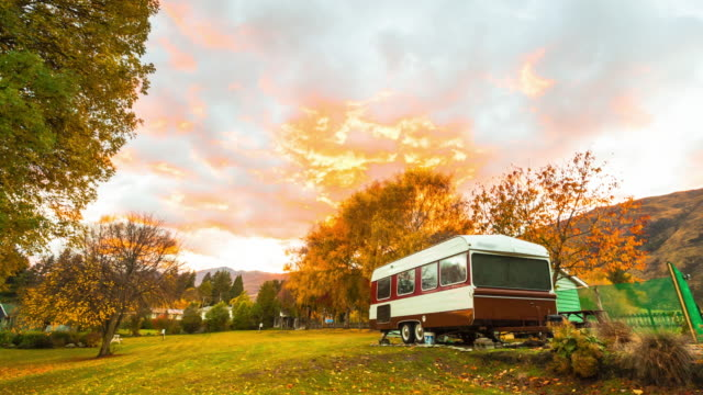 4K: Autumn sunrise at a family park, with camper vans at New Zealand video