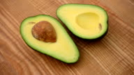 Avocado on a chopping board. video