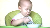 Baby bangs spoon on plate video