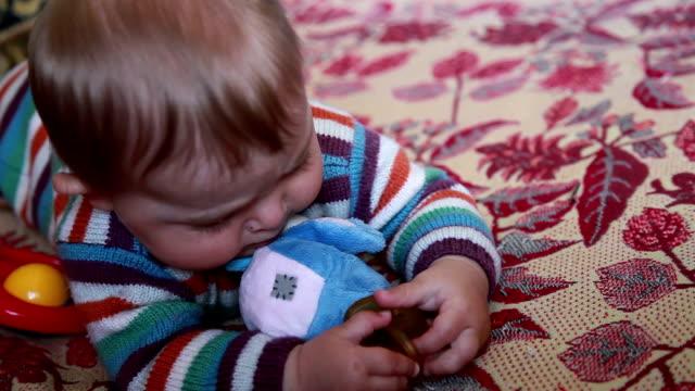 Baby biting pacifier in her hands video