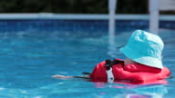 Baby Boy Floating with Life Jacket In Swimming Pool video