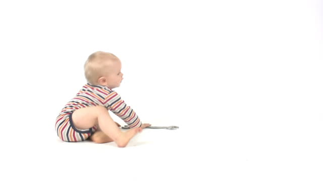 Baby boy holding wrench tool video