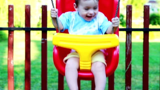 baby boy in swing video