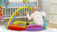HD DOLLY: Baby Boy Playing On The Playmate video