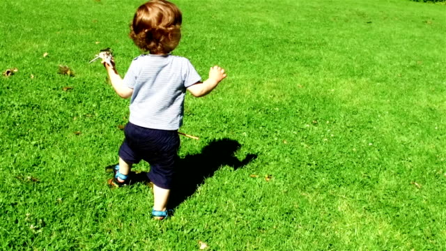 SLOW MOTION: Baby boy playing video
