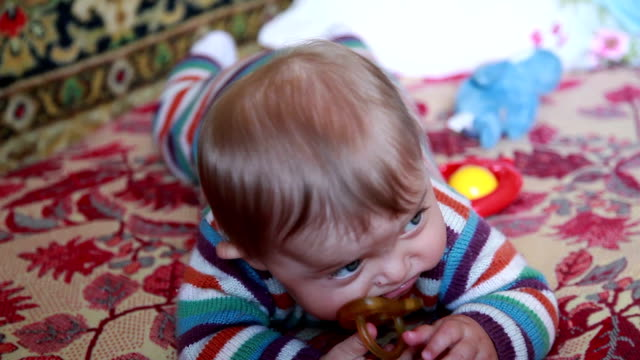 Baby chewing pacifier video