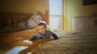 baby crawling in bed video