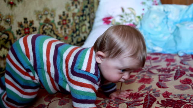 Baby crawling on the bed video