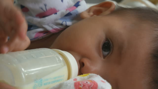Baby drinking herself bottle video
