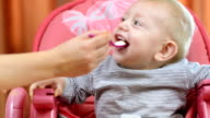 Baby Eating in a High Chair video