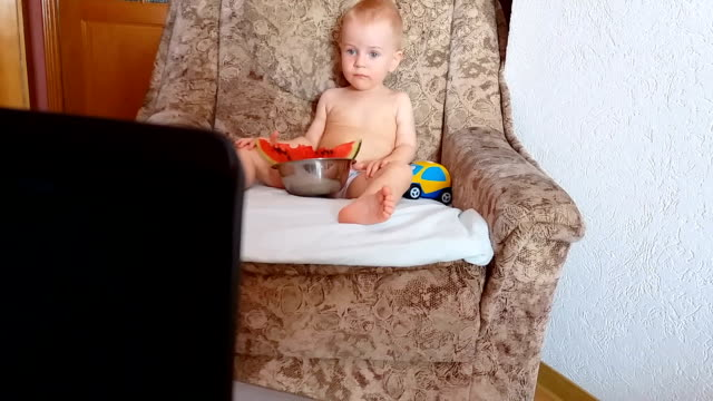 Baby eating watermelon, playing and watching cartoons video