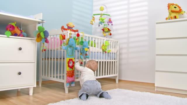 HD CRANE: Baby Exploring Crib Toys video