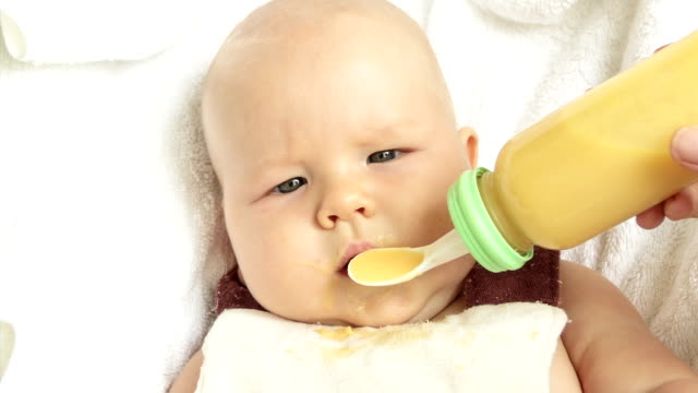 Baby Feeding With Spoon Feeder video