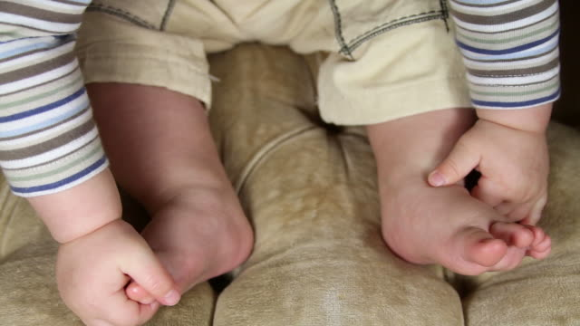 Baby feet and hands video