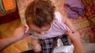 Baby getting dressed. Pov video