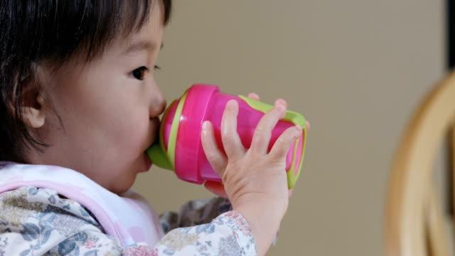 baby girl drinking milk video